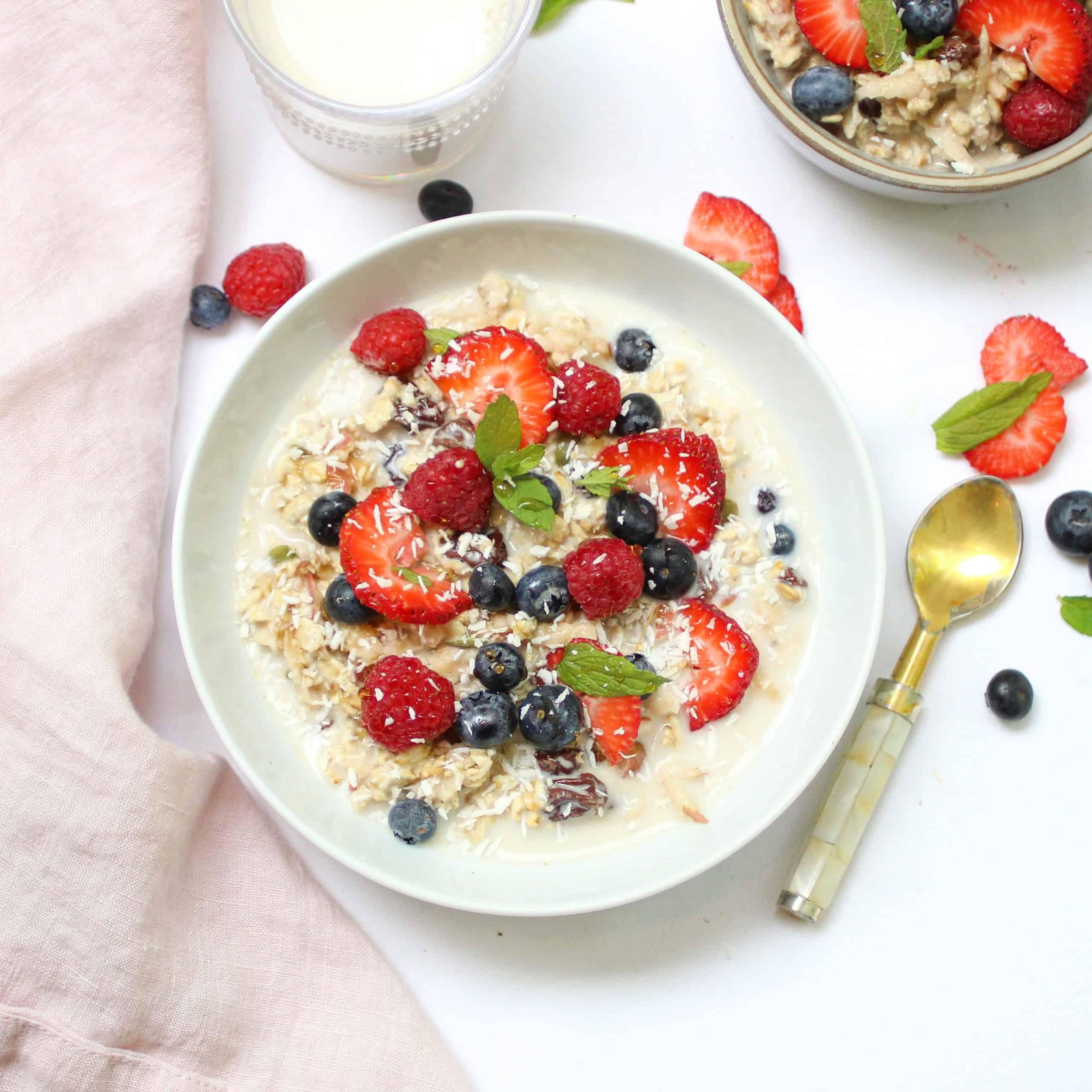 a bowl of vegan bircher muesli and berries